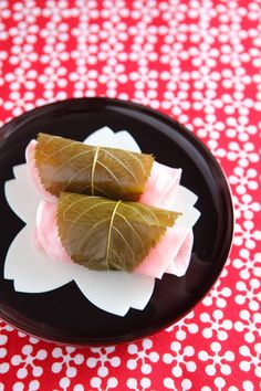 【さくら餅】  【Sakura mochi】It's a Sakura (cherry blossom) flavored sweet rice. We can enjoy a salty Sakura leaf around mochi & sweet red bean paste inside mochi at the same time.  We always eat this when spring comes!