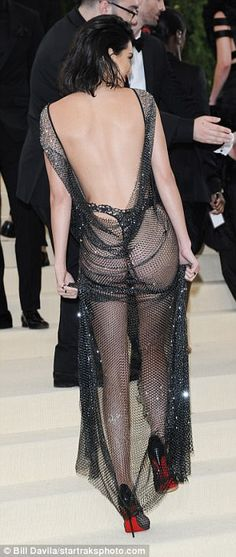 Cheeky! The top model showed off her derriere in all its glory as she twirled and posed fo...