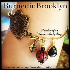 "BurnedinBrooklyn on Instagram: ""I love this BurnedinBrooklyn beauty. A sweet little leaf with golden marcasite, charming Wooden Lady bug with Swarovski Crystal head & faceted Onyx tear drop all connected with a beautiful filigree bronze flower make our lovely LadyBug bangle. Find it in our Etsy Shop: www.etsy.com/shop/BurnedinBrooklyn #burnedinbrooklyn #sweet #love #handmade"""