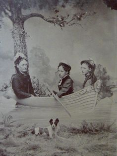 3 Women in a Boat. Dog apparently not invited into boat.