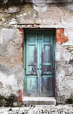 Erice, Italy (old wooden door centre wall) - a photo by NHM