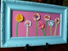 painted frames, wall art, spring flowers, button flowers, flower art, kid rooms, girl bedrooms, little girl rooms, wall flowers