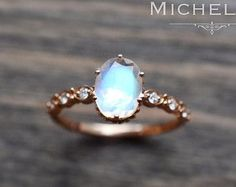 「Daphne」  Note: Last picture shows the ring in 14K White Gold and matching leaf wedding band - the band needs to be purchased separately and is NOT included in this listing price.  Inspired by the Greek Laurel Tree Goddess Daphne, this vintage-inspired moonstone engagement ring combines the elements of Art Nouveau and an elegant modern touch. Made in your choice of 14K or 18K solid gold with genuine diamonds.  Main Stone: Natual Moonstone, faceted cut, 7mm*7mm Accent Stone: Genuine diamonds…