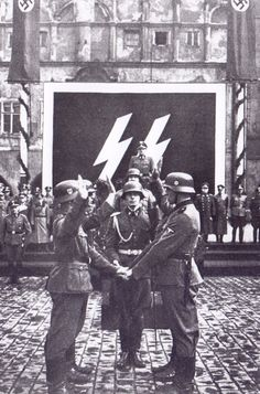 German SS soldiers taking the oath   my father fought and hated these things he was in control of a enemy pow camp and the villagers would come and beg him to let them kill the  ss