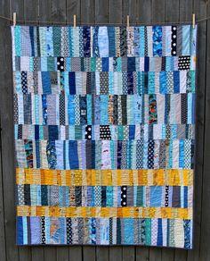 The yellow and kismet of this quilt makes me smile. Modern quilts don't have to be modern fabrics. Small World Quilt by Lucia, an original design featured on her blog.