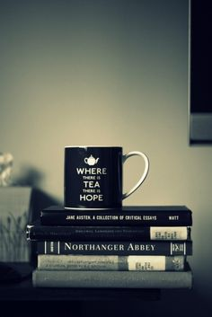 A cup of tea and a good book. What a perfect combination- I'm pinning this 'cause I love the cup :)