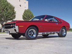 AMC muscle car (Javelin?)   CLOSE, ACTUALLY  CAR IS A  AMX