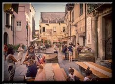 Tables in the square by Giancarlo Gallo