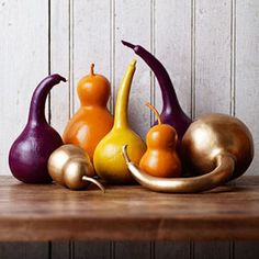 Decorating Ideas for Autumn...paint dried gourds with rich shades of purple, orange, yellow and gold.