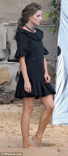 Legs eleven: For one of her last looks the 27-year-old showed off her slender legs in a winter ruffle skirted dress