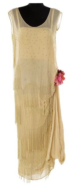 """~Marion Davies beige flapper dress from an unidentified production. (ca. 1930) Beige chiffon flapper dress sprinkled with rhinestones along top which represent raindrops and umbrellas of faux pearls on the bottom half with silk under slip and faux red and pink flowers at hip. Black United Costumers label handwritten, """"Marion Davies""""~"""