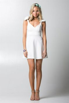 $40.50 Ivory Fit and Flare Bow Detail Dress www.shopthepinkroomboutique.com