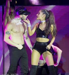 Meow: Ariana was accompanied on stage by hunky shirtless men and women clad in racy crop tops and skin-tight leggings