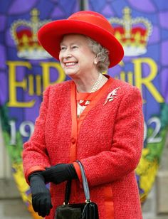 Queen Elizabeth II in front of Golden Jubilee banners on the grounds of Old Brunswick House. Fredericton, New Brunswick. October 11, 2002.