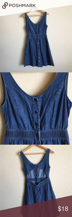 Blue denim look dress! Really cute, buttons in the front, elastic waist, cutout in the back with buttons. Size small Forever 21 Dresses