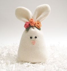 A great addition to your Easter or spring table display, sitting on the counter or a shelf, or keeping you company on your desk.  -:¦:- DESCRIPTION -:¦:- This cutie is constructed from a white felted wool sweater. She has two black bead eyes and a cute little pink nose. She has a white ribbon and her little bunny tail is an off-white felted wool ball. Rosebud is stylin in her flower crown or carrot bouquet - optional additions you can choose at checkout! If you want your flower(s) to be a…