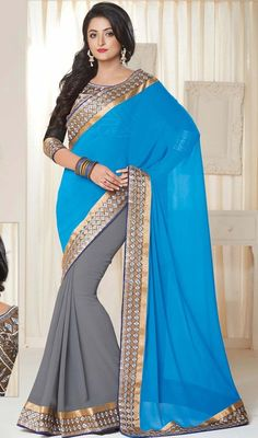 Trendy azure blue, gray embroidered chiffon sari is a half n half sari which is embellished with golden woven lace, silk thread embroidered geometrical shapes and crystal stones which makes you too look quite stylish and graceful. Sari pairs with contrast brown raw silk stitched blouse as shown in the picture. #LatestEveningWearSarees