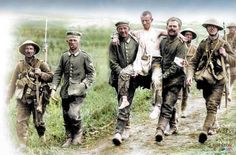 British soldiers with wounded German prisoners, La Boisselle, 22 miles (35 km) north-east of Amiens. 3rd of July 1916. [Colorized by Royston Leonard]