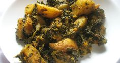 Classic dry Indian curry of potatoes and spinach simmered in tomatoes and spices