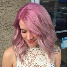 Pastel pink color melt perfection from stylist Alex. We love the orchid roots that fade into a light cotton candy lavender pink. Aveda color formula in comments.