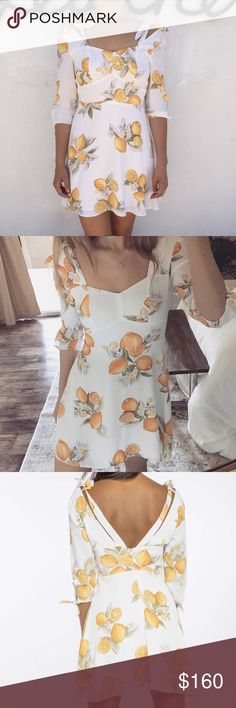 For Love & Lemons Limonada Mini Dress Your favorite Spring & Summer dress is here! For Love & Lemons Limonada Mini Dress is it! This beautiful dress is a one-of-a-kind lemon print featuring playful details with elbow ties, decorative shoulder straps, open back detailing and a super flattering fit with a flirty flared hemline. This dress gives us all the wanderlust and is clearly perfect for any adventure or vacation.   Material: Rayon crepe.  Fit: Tailored waist yoke. Lined. Invisible…
