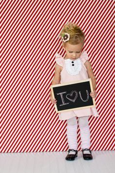 This little girl is too cute!  Love her outfit and the photo set up! Would be a cute V-day gift for Dad!