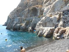 Diving at the ancient harbor, Kamari Beach, Santorini, Greece.   Um, yes the blue and black object going headfirst into the water is me.
