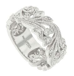 This lovely 14K white gold floral wedding band is a rush of swaying blooms and ornamental grasses. The romantic, sparkling wedding ring is set with .44 carat total weight of diamonds and edged with a delicate milgrain decoration. The ring measures 8.04 mm in width. Size 6 3/4. We can re-size. We can order in any size. Also available in 18K, yellow gold and platinum.