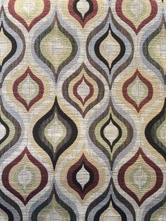 The Whole 9 Yards   Pattern: Garret, Color Name:Redstone Fabric Content: 82% Polyester, 18% Cotton Fabric Width: 58.5″ Repeat: Horizontal: 7.5″ Vertical: 11.5″ Price: $29.99  midcentury modern, ogee pattern