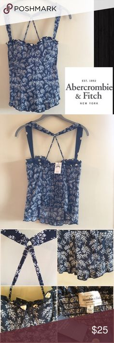 NWT Abercrombie & Finch Printed Corset Bustier Pretty and flirty navy blue corset silhouette bodice with boning through-out. Pattern are of small flowery bunches and interior and trim are of beige polka dots. Neck hem are lined with ruffled polka dots. Bust is slightly padded with an underwire. Shoulder straps are of thick at front and fades to thin adjustable criss cross that is flattering. Back are fully ruched for comfort and leeway. Bottom hem are slightly ruffled thru-out. A top for…