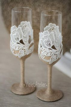 Rustic set of 2 toasting flutes with white lace and burlap twine. A perfect addition to rustic, country and country chic weddings, outdoor weddings and an impressive detail for Bride and Grooms wedding toast. Each glass is wrapped by twine and floral lace with large roses. Glasses are