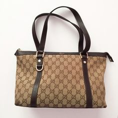 """Gucci Abbey Med Tote Abbey medium shoulder bag with double straps,zip-top closure,gucci logo,D ring details,and inside zip pocket. Beige/ebony GG fabric with dark brown leather trim and light gold hardware.Size: 12.6"""" X 9"""" X 5"""". It comes with: a Gucci dust bag, all the accessories in the pic minus the receipt cause it has my personal info and the box (dented). Corners show wear which happening to all Gucci bag of this material. No major stains or holes. Great Condition for a used bag. Gucci…"""