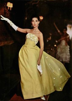 Dress by Jean Patou 1958 fashion style yellow gown long skirt strapless white flowers 50s 60s color photo print ad model magazine