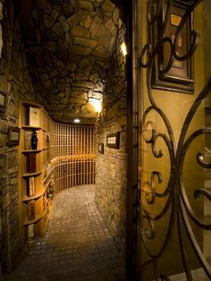 Mediterranean Wine Cellar with Designer series 95-bottle 5-column wine rack with display row, specialty door, Wall sconce