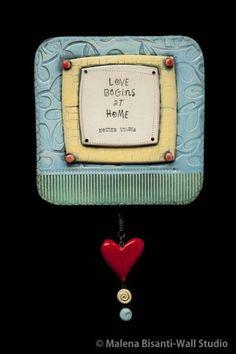 Love Begins at Home - Mother Teresa ceramic wall sculpture.  © Malena Bisanti-Wall.  www.mbwstudio.com.