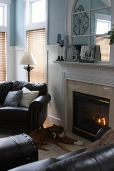 Black, white, light blue..love the mirror above the fireplace!