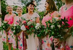 Image by Lucabella Photography - A Catherine Deane bridal gown for a colourful outdoor wedding with gold cutlery and pink bridesmaid dresses and a Sophie and Luna flower crown with lawn flamingos and a baja band by Lucabella Photography