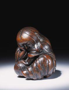 Figure of a sleeping Shojo, a mythical creature  with a liking for drinking sake. A kindly creature from Japanese mythology, Shojos live on the bottom of the sea.  Netsuke - Japan, 1750-1850