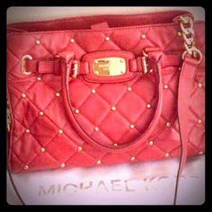 Michael Kors Bag Very pretty, red, with gold studs, one long strap that's half gold chain, two smaller straps, quilted look, large Michael Kors bag. Great condition. Trade = $200 Michael Kors Bags Shoulder Bags