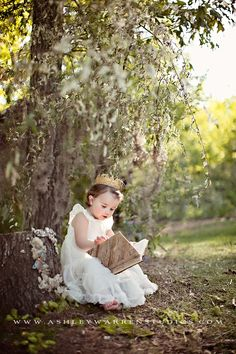 crown and a cute book with all the spanish moss, with all her stuffed animals around