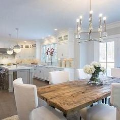 Dining open to kitchen - love the white, the island, the dining room chairs and that wood table! (Note: I mirrored the original image to match my design) by sonya