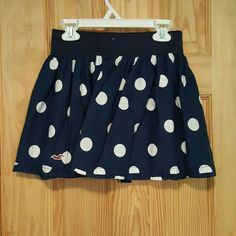 Hollister mini skirt Don't wear too much. Great condition ! Navy blue with white polka dots. Hollister Skirts Mini