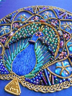 Hand embroidered peacock on silk. Beads, sequins, embellishments, goldwork and silk shading
