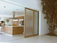 These opaque glass panels function much like Japanese shoji panels, but have an attractive modern look.
