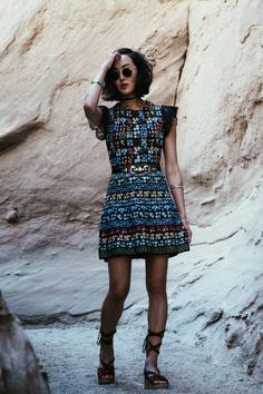 Chriselle Lim is a vision in bohemian glamour in this gorgeous technicolour floral print dress, paired with strappy gladiator sandals and a pair of vintage style shades. Dress: Valentin, Shoes: Sigerson Morrison, Sunnies: Rayban.