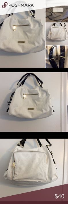 White and black authentic Steve Madden bag Gently used but in very good condition. Inside is spotless. This is a large size bag that has a small zip pocket in the front and a large zip pocket in the back on the outside. Two pocket organizers on the inside and one inner zip pouch. The bag is made of a pebbled kind of leather. It is missing the cross body strap. Steve Madden Bags Totes