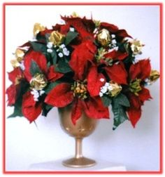 """RED POINSETTIA & CHOCOLATE BUDS"" Candy Bouquet : Our 24 ""Rosebuds"" are made from Chocolatier chocolates, and combined with beautiful red Poinsettias, this chocolate bouquet is an impressive Christmas centrepiece.    Price as shown AUD $64.95     Code: CB 035"