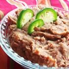 Crockpot refried beans  Ingredients      * 1 onion, peeled and halved      * 3 cups dry pinto beans, rinsed      * 1/2 fresh jalapeno pepper, seeded and chopped      * 2 tablespoons minced garlic      * 5 teaspoons salt      * 1 3/4 teaspoons fresh ground black pepper      * 1/8 teaspoon ground cumin, optional      * 9 cups water