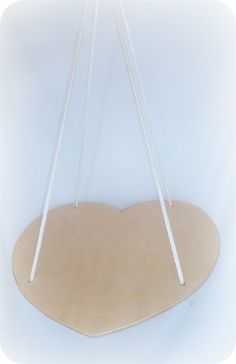 Lila's Swing (Heart Platform Swing) - Useful in the development of a child's vestibular system by forcing them to accept more movement sensations. Different movement sensations and repetitive swinging motion has been known to help calm and regulate and over stimulated child