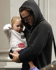 Heath Ledger strolls in the rain with his daughter Matilda in October 2007.